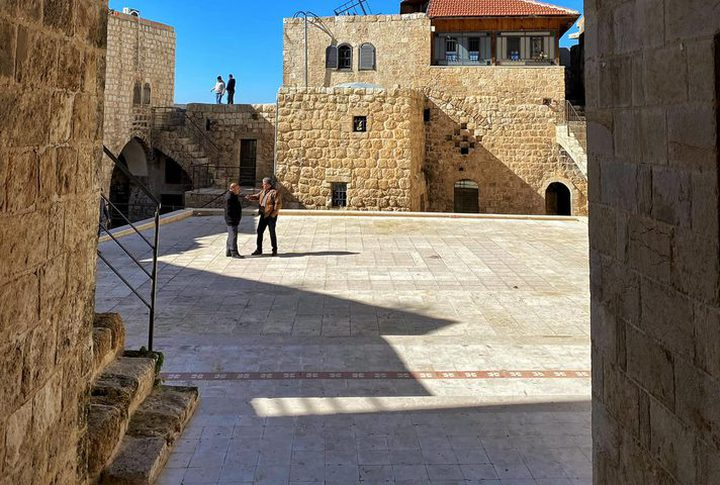 A tour in Al-Khawaja Castle in the center of Ni'lin village, west of Ramallah